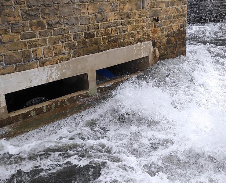 Needle valve in dam for base drainage